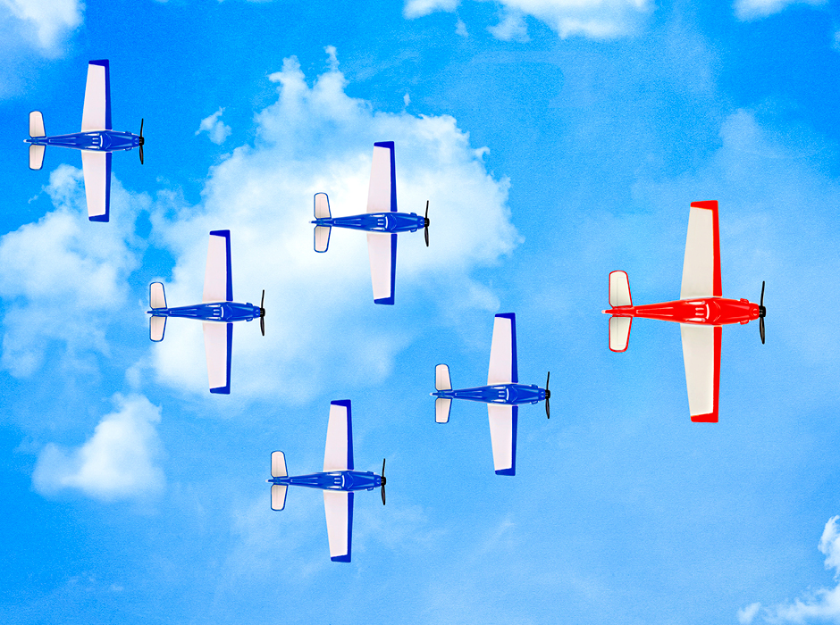 Red Airplane Flying Ahead Of Five Blue Airplanes In Cloudy Sky
